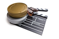 Clapper board with film reels Royalty Free Stock Photo