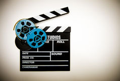 Clapper board and 8mm film reels color effect Royalty Free Stock Photo