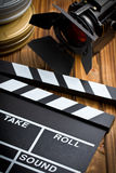 Clapper board with movie light Royalty Free Stock Photos
