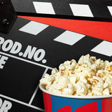 Clapper board and popcorn box Royalty Free Stock Image