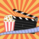 Clapper board with popcorn, filmstrip on vintage grunge poster. Vector illustration Royalty Free Stock Photography