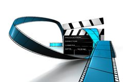 Clapper Board and Reel. Dynamic 3d Clapper board and film reel in blue and black on white back drop Royalty Free Stock Images