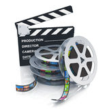 Clapper board and reels with filmstrips. Cinema, movie, film and video media industry concept: clapper board and stack of metal film reels with filmstrips with Stock Photography