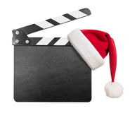 Clapper board with Santa's hat on it isolated. On white Royalty Free Stock Photography