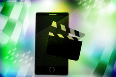 Clapper board with a smart phone. In color background Stock Photography