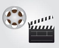 Clapper board and video film. Black and white clapper board and gray and brown video film Royalty Free Stock Image