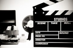 Clapper board with vintage movie editing desktop in black and wh Royalty Free Stock Photos