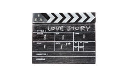 Clapper board on white background Title Love story. Wooden clapper board on white background Title Love story Stock Image