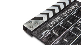 Clapper board on white background Title Love story. Wooden clapper board on white background Title Love story Royalty Free Stock Image