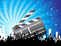 Clapper and crowd on blue background. A clapper and crowds on the blue ray background Royalty Free Stock Images