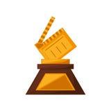 Clapper ekranowy trofeum nagradza złotego Zdjęcie Stock