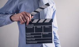 Clapper f?r maninnehavfilm framst?llning av film arkivfoton