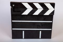 Clapper for indicating the beginning of a film or video clip made of wood and painted black and white with stripes in the closed stock images