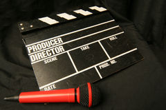 Clapper and microphone. Tools for the direction of the movie, video or show stock images