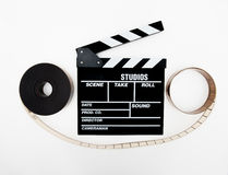 Clapper and 35mm reel isolated. On white background stock image