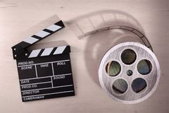 Clapper open and reel on wooden table stock images