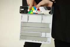 Clapper for shooting movies, A person`s hands, is going to write on the flapper stock image