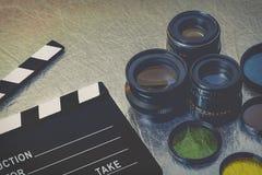 Clapperboard和透镜 免版税库存照片