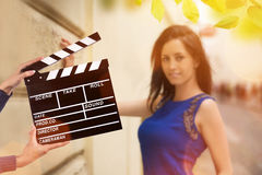 Clapperboard由女性手的标志举行 免版税图库摄影