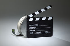 Clapperboard. And the film reel on the plain background Royalty Free Stock Photography