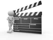 Clapperboard. 3d people -human character and a clapperboard. 3d render illustration Stock Photos