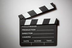 Clapperboard bio på vit Arkivfoto