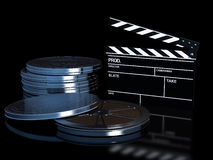 Clapperboard and cinema film roll. High resolution 3d render of an clapperboard and 5 film rolls on a black and reflective studio floor Stock Photos