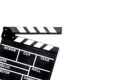 Clapperboard de la película en el copyspace blanco de la opinión superior del fondo Fotografía de archivo libre de regalías