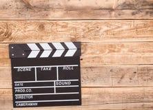 Clapperboard en la madera Foto de archivo libre de regalías