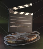 Clapperboard Film. Clapperboard and roll of film in the retro concept cinema Stock Photo
