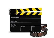 Clapperboard and film strip Royalty Free Stock Photos