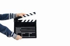 Clapperboard-Griff durch Kinderhände Stockbilder