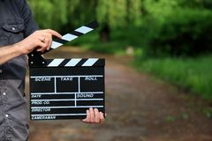 Clapperboard in hand stock photography