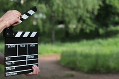 Clapperboard in hands Royalty Free Stock Photos