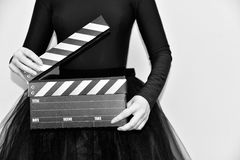 Clapperboard in hands. Woman holding a clapperboard, white & black Stock Photos