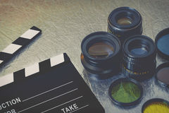 Clapperboard and lenses. Clapperboard, lenses and filters on the table Royalty Free Stock Photo