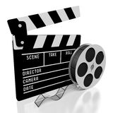 Clapperboard, movies concept. Clapperboard and movie tape - great for topics like cinema/ movie theater, entertainment, movies/ films etc Stock Photos