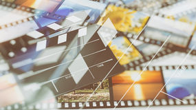 Clapperboard na filmstrips Obrazy Royalty Free