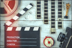 Clapperboard, reel, film and old movie camera Stock Image