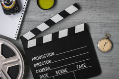 Clapperboard, a roll of film and watch Royalty Free Stock Images