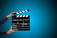 Clapperboard sign hold by female hands. Stock Photography