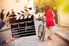 Clapperboard sign hold by female hands. Stock Photo