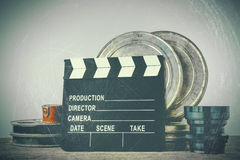 Clapperboard, tin boxes with film and lens Royalty Free Stock Images