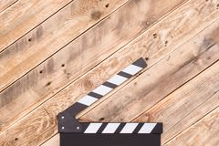 Clapperboard on wood background Stock Image
