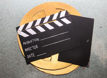 Clapperboard wooden wheel in the background Stock Images
