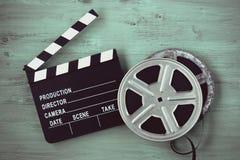 Clapperboards och två rullar av film royaltyfria bilder