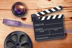 Clapperboards and the reel of film. Film reel, lens and movie clapper in retro composition Stock Photo
