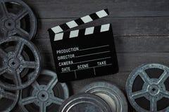 Clapperboards und Spule des Filmes Stockbilder