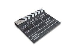 Clapperbräde på den vita berättelsen för bakgrundstitelBad Arkivfoto