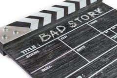 Clapperbräde på den vita berättelsen för bakgrundstitelBad Fotografering för Bildbyråer